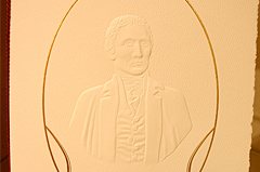 Upscale, commemorative piece for the unveiling of a marble bust of Meriweather Lewis at the Capitol Building using, multi-level blind emboss, with metallic printing on parchment paper with and formal tassle - Imagery encircling blind emboss was another emboss printed with gold foil process